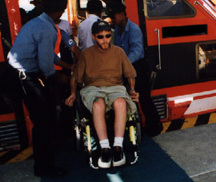 person in a wheelchair not being restricted by disability, on a cruise ship