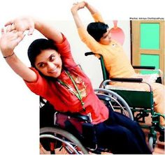 a girl in a wheelchair doing yoga