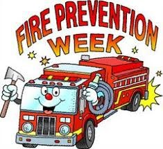 A smiling fire truck in the fire prevention week logo