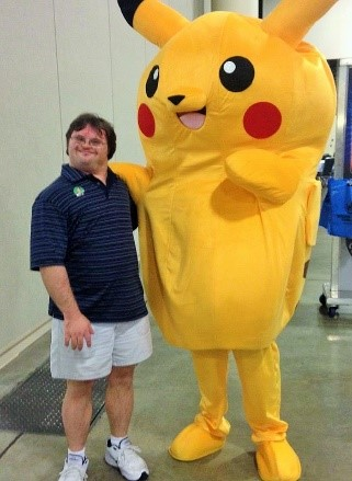 Karl Hunt with a large yellow pokemon