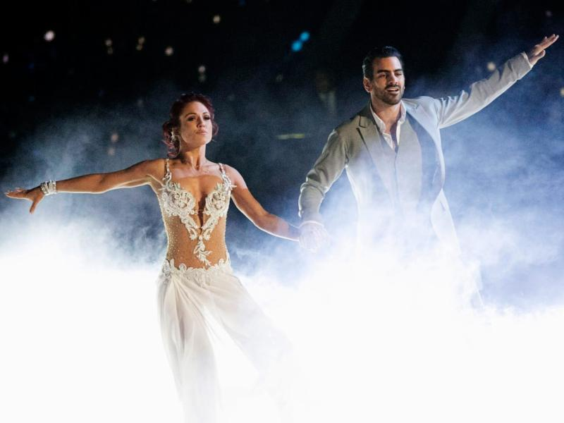An action shot of a man and a woman dancing