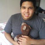 Arnaldo Rios Soto holding a teddy bear