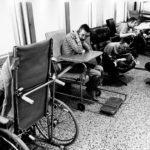 black and white pictures of persons in wheelchairs in an institutional setting