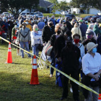 People waiting on a long line to get a vaccine